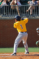 Jose Torralba (1) of the Canisius Golden Griffins at bat against the Charlotte 49ers at Hayes Stadium on February 23, 2014 in Charlotte, North Carolina.  The Golden Griffins defeated the 49ers 10-1.  (Brian Westerholt/Four Seam Images)