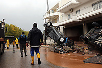 Pictured: A car sits almost upright against debris in the middle of the road.<br /> Re: People have died, some still missing and severe damage caused by heavy rain and flash flooding in the area of Mandra, near Athens, Greece. Thursday 16 November 2017