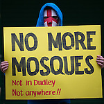 © Joel Goodman - 07973 332324 .  07/02/2015 . Dudley , UK . Supporter with NO MORE MOSQUES sign . Approximately 500 EDL supporters at an English Defence League demonstration in Dudley , in the West Midlands , this afternoon ( Saturday 7th February 2015 ). They oppose the building of a new mosque in Dudley . Photo credit : Joel Goodman