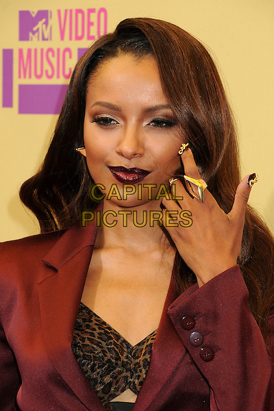 Kat Graham.Arrivals at the The 2012 MTV Video Music Awards held at Staples Center in Los Angeles, California, USA..September 6th, 2012.VMA's VMAS VMA headshot portrait pink lipstick dark maroon burgundy jacket leopard print blazer hand gold rings nail varnish polish .CAP/ADM/BP.©Byron Purvis/AdMedia/Capital Pictures.