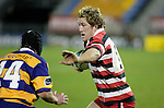 James Maher prepares to fend off Charles Baxter. Counties Manukau Steelers vs Bay of Plenty Steamers warm up game played at Mt Smart Stadium on 14th of July 2006. Counties Manukau won 25 - 20.