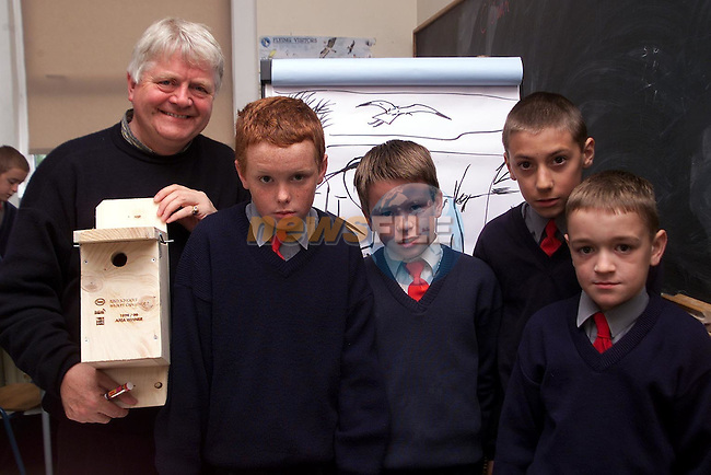 TV personality and wildlife artist Don Conroy presenting Donacarney students Robert Cowley, Paul Kelleher, Kevin Conaghy and Guillaume Martine with thier prize in the Esso School's Wildlife Challange..Picture Paul Mohan Newsfile