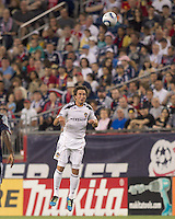 Los Angeles Galaxy defender Omar Gonzalez (4) heads the ball. In a Major League Soccer (MLS) match, the Los Angeles Galaxy defeated the New England Revolution, 1-0, at Gillette Stadium on May 28, 2011.