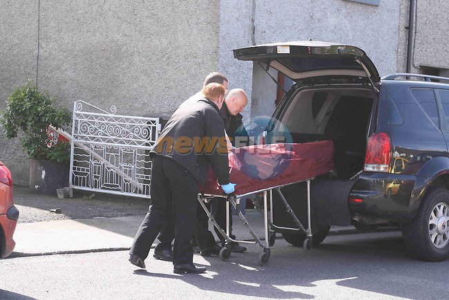 Body of a Polish  national being removed from the murder scene on Duleek Street, Drogheda...Photo NEWSFILE/Jenny Matthews.(Photo credit should read Jenny Matthews/NEWSFILE)....This Picture has been sent you under the condtions enclosed by:.Newsfile Ltd..The Studio,.Millmount Abbey,.Drogheda,.Co Meath..Ireland..Tel: +353(0)41-9871240.Fax: +353(0)41-9871260.GSM: +353(0)86-2500958.email: pictures@newsfile.ie.www.newsfile.ie.FTP: 193.120.102.198.
