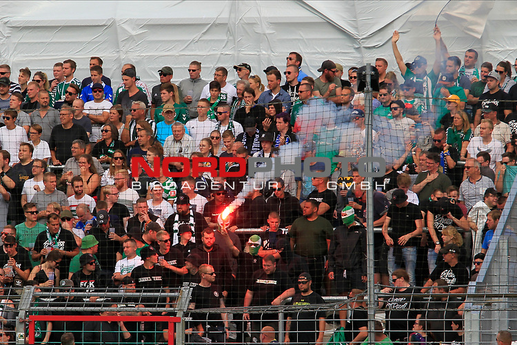 11.08.2019, Stadion Lohmühle, Luebeck, GER, DFB-Pokal, 1. Runde VFB Lübeck vs 1.FC St. Pauli<br /> <br /> DFB REGULATIONS PROHIBIT ANY USE OF PHOTOGRAPHS AS IMAGE SEQUENCES AND/OR QUASI-VIDEO.<br /> <br /> im Bild / picture shows<br /> Luebecker Fans mit Pyro<br /> <br /> Foto © nordphoto / Tauchnitz
