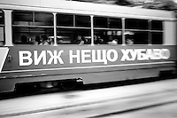 A street car that read SEE SOMETHING BEAUTIFUL, passes on Vitosha Boulevard, Sofia, Bulgaria