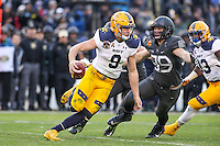 Baltimore, MD - December 10, 2016: Navy Midshipmen quarterback Zach Abey (9) avoids a sack during game between Army and Navy at  M&T Bank Stadium in Baltimore, MD.   (Photo by Elliott Brown/Media Images International)