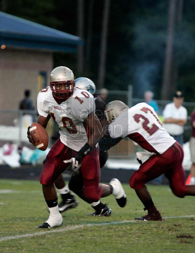 Creekside High School quarterback Eric Berry versus Starr's Mill High School on Friday, Sept. 15, 2006. In high school football, Berry ran for 4,491 yards and had 3,532 yards in passing.<br />