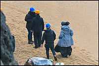 BNPS.co.uk (01202 558833)<br /> Pic: Graham Hunt/BNPS<br /> <br /> Saoirse Ronan filming at the fossil laden cliffs at Charmouth this afternoon.<br /> <br /> Film crew and actors on the Beach at Charmouth in Dorset today for the filming of the new film Ammonite about the life of fossil hunter Mary Anning starring Kate Winslet and Saoirse Ronan.<br /> <br /> Kate Winslet taking a ride in an off road buggy to her next filming location.