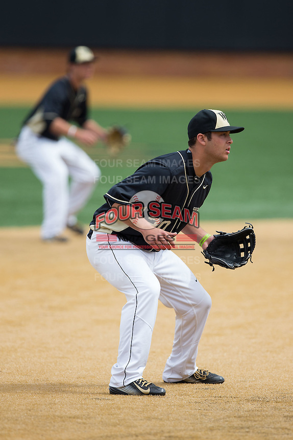 Wake Forest Demon Deacons third baseman Justin Yurchak (20) on defense against the Miami Hurricanes at Wake Forest Baseball Park on March 22, 2015 in Winston-Salem, North Carolina.  The Demon Deacons defeated the Hurricanes 10-4.  (Brian Westerholt/Four Seam Images)