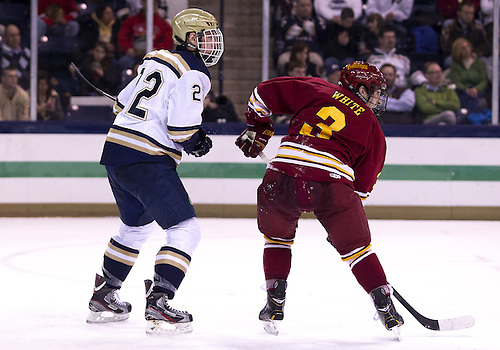 January 25, 2013:  Notre Dame left wing Mario Lucia (22) and Ferris State defenseman Travis White (3) battle for position during NCAA Hockey game action between the Notre Dame Fighting Irish and the Ferris State Bulldogs at Compton Family Ice Arena in South Bend, Indiana.  Ferris State defeated Notre Dame 3-1.
