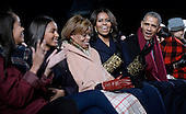United States President Barack Obama and daughters Malia and Sasha, mother-in-law Marian Robinson and first lady Michelle Obama smile during the National Christmas tree lighting ceremony on the Ellipse south of the White House December 3, 2015 in Washington, DC. The lighting of the tree is an annual tradition attended by the President and the first family.<br /> Credit: Olivier Douliery / Pool via CNP