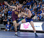 SIOUX FALLS, SD - NOVEMBER 11: Zach Carlson from South Dakota State battles with Austyn Harris from Arizona State during their 197 pound match Sunday afternoon at the Sanford Pentagon in Sioux Falls, SD.  (Photo by Dave Eggen/Inertia)