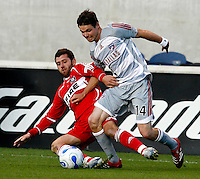 Chicago Fire defender Gonzalo Segares (25) and FC Dallas defender Drew Moor (14) battle for the ball.  FC Dallas defeated the Chicago Fire 2-1 at Toyota Park in Bridgeview, IL on May 17, 2007.