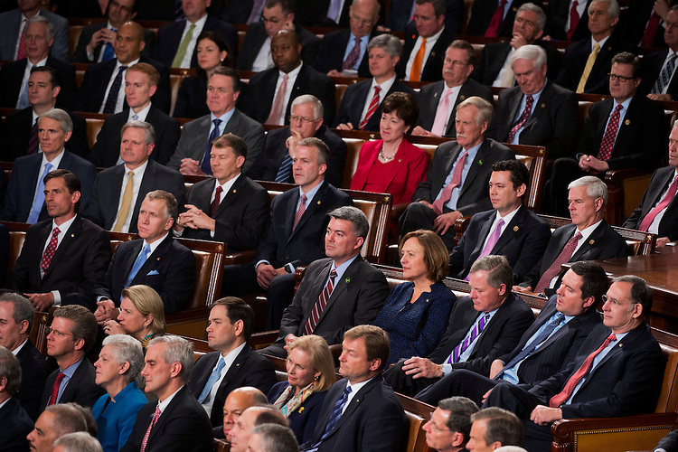 UNITED STATES - JANUARY 20: Members, including Sen. Cory Gardner, R-Colo., listen to President Barack Obama deliver his State of the Union address in the in the Capitol's House chamber, January 20, 2015. (Photo By Tom Williams/CQ Roll Call)