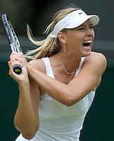 Maria Sharapova (RUS) (24) against Viktoriya Kutuzova (UKR) in the first round of the Ladies SIngles. Sharapova beat Kutuzova 7-5 6-4  ..Tennis - Wimbledon - Day 1 - Mon 22nd June 2009 - All England Lawn Tennis Club  - Wimbledon - London - United Kingdom..Frey Images, Barry House, 20-22 Worple Road, London, SW19 4DH.Tel - +44 20 8947 0100.Cell - +44 7843 383 012.