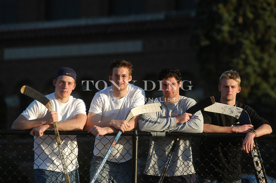 Michigan freshmen and hockey players Matt Hunwick, Tim Cook, Mike Brown, and Mike Mayhew, in front of Yost Ice Arena on Tuesday, October 7, 2003. (TONY DING/Daily)
