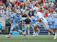 Annapolis, MD - May 20, 2018: Johns Hopkins Blue Jays Thomas Guida (27) aviods a Duke Blue Devils defender during the quarterfinal game between Duke vs John Hopkins at  Navy-Marine Corps Memorial Stadium in Annapolis, MD.   (Photo by Elliott Brown/Media Images International)