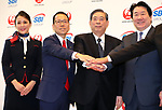 """October 3, 2017, Tokyo, Japan - Japan Airlines (JAL) president Yoshiharu Ueki (R) shakes handds with SBI Holdings president Yoshitaka Kitao (2nd R) and JAL SBI Fintech president Satoshi Nishi (2nd L) as they announce to form a joint venture """"JAL SBI Fintech"""" at JAL headquarters in Tokyo on Tuesday, October 3, 2017.  JAL SBI Fintech will launch the business of multi-currency prrpaid card next year.   (Photo by Yoshio Tsunoda/AFLO) LWX -ytd-"""