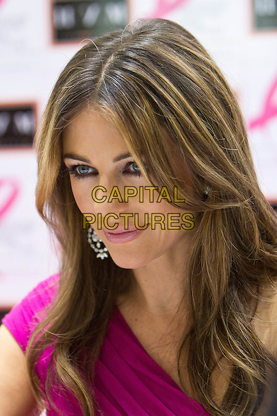 Elizabeth Hurley.Estee Lauder Companies' Breast Cancer Awareness (BCA) Campaign in TSUM, Moscow, Russia..October 6th, 2011.headshot portrait dangling earrings silver pink one shoulder liz.CAP/PER/SB.©SB/PersonaStars/CapitalPictures