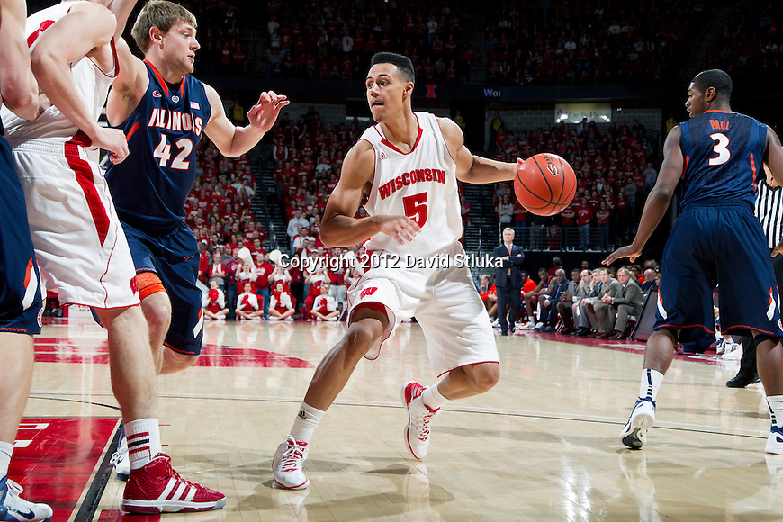 Wisconsin Badgers guard Ryan Evans (5) handles the ball during a Big Ten Conference NCAA college basketball game against the Illinois Fighting Illini on Sunday, March 4, 2012 in Madison, Wisconsin. The Badgers won 70-56. (Photo by David Stluka)