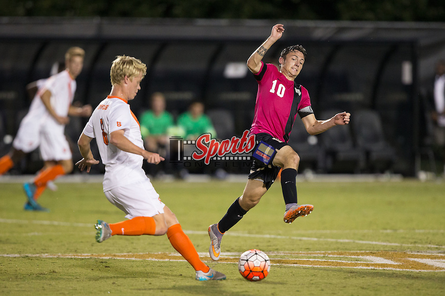 Michael Gamble (10) of the Wake Forest Demon Deacons tries to block a pass by Jonathan Hagman (8) of the Syracuse Orange during first half action at Spry Soccer Stadium on September 19, 2015 in Winston-Salem, North Carolina.  The Demon Deacons defeated the Orange 3-1.  (Brian Westerholt/Sports On Film)