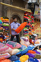 man selling wool on the streets of Varanasi, India