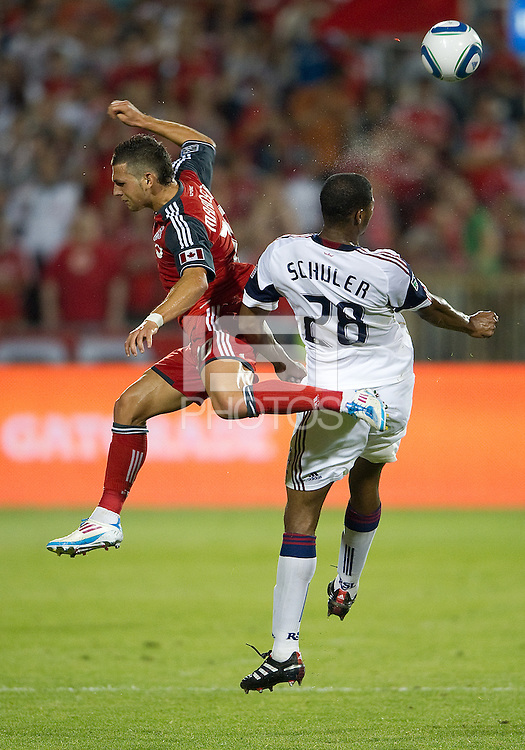 13 August 2011: Real Salt Lake defender Chris Schuler #28 and Toronto FC forward Peri Marosevic #70 in action during a game between Real Salt Lake and Toronto FC at BMO Field in Toronto..Toronto FC won 1-0.
