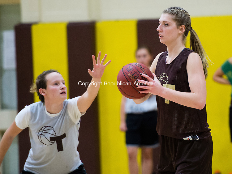 THOMASTON, CT- 30 November 2015-113015EC01-   Thomaston basketball's Casey Carangelo passes in front of teammate Charlotte Eberhardt. Monday was the first day of practice for the Golden Bears. Erin Covey Republican-American