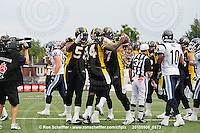 September 6, 2010; Hamilton, ON, CAN; Hamilton Tiger-Cats running back DeAndra' Cobb (14) celebrates his touchdown with offensive lineman Belton Johnson (56) and offensive lineman Peter Dyakowski (67). CFL football: Labour Day Classic - Toronto Argonauts vs. Hamilton Tiger-Cats at Ivor Wynne Stadium. The Tiger-Cats defeated the Argonauts 28-13. Mandatory Credit: Ron Scheffler.