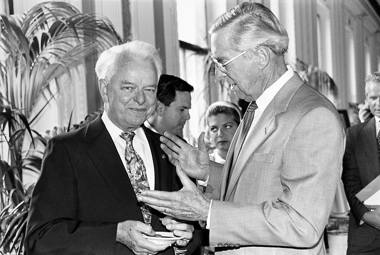"""Sen. Robert Carlyle """"Bob"""" Byrd, D-W.Va. and Sen. Lloyd Millard Bentsen, D-Tex. at reception at the  Library of Congress celebrating Byrd's new book on the Senate, Volume II. Several members were in attendance. Senator Dole referred to Sen. Byrd as the """"mother of all Senate historians."""" July 1991 (Photo by Maureen Keating/CQ Roll Call)"""
