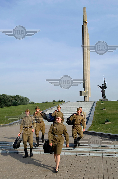 Soldiers in front of the obelisk erected in tribute to the Red Army's liberation of Belarus in World War Two (WWII).