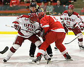 Pier-Olivier Michaud (Harvard - 39) and Sean Collins (Cornell - 12) battle on the opening face-off. - The visiting Cornell University Big Red defeated the Harvard University Crimson 2-1 on Saturday, January 29, 2011, at Bright Hockey Center in Cambridge, Massachusetts.