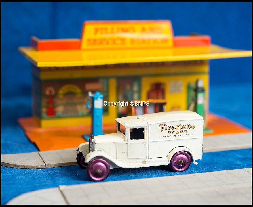BNPS.co.uk (01202 558833)<br /> Pic: PhilYeomans/BNPS<br /> <br /> Firestone tyres.<br /> <br /> Dinky dynamite...<br /> <br /> The 'Holy grail' of Dinky car collectors are being sold  at The first two sets of Dinky Toys ever made have sold for almost &pound;50,000 in a landmark auction.<br /> <br /> In a sale the likes of which has never been seen before, the 12 ultra-rare Dinky Toys from 1933 were snapped up by a private collector for almost twice their estimate.<br /> <br /> Experts at Special Auction Services in Newbury, Berks, had tipped the two boxes of six delivery vans to fetch &pound;15,000 each but after fierce bidding they sold for &pound;20,000 and &pound;19,000 respectively.<br /> <br /> With sale room fees and VAT added the total was &pound;46,000.