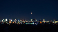 Crest moon over Manila skyline at twilight,Philippines