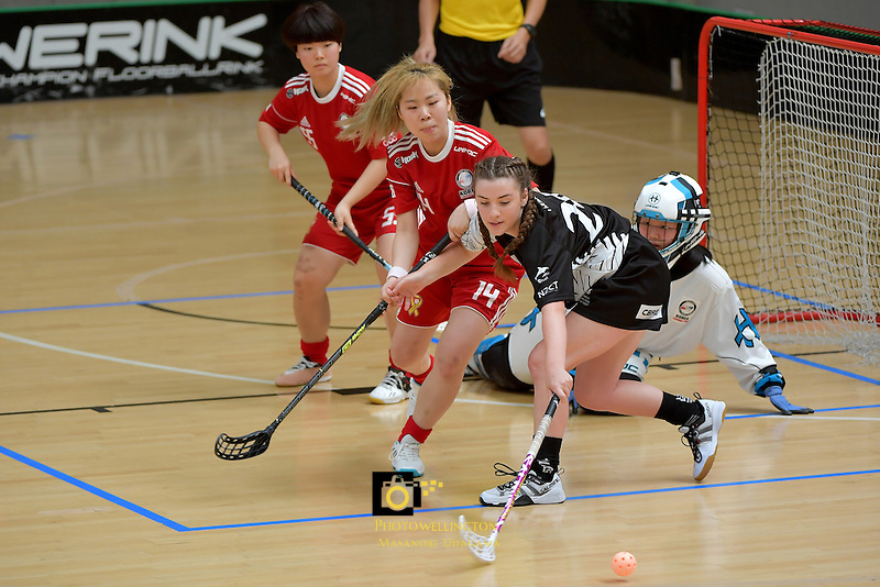 Korea's Boram Yoon and New Zealand's Ashleigh Mudge in action during the World Floorball Championships 2017 Qualification for Asia Oceania Region - New Zealand v Korea at ASB Sports Centre , Wellington, New Zealand on Sunday 5 February 2017.<br /> Photo by Masanori Udagawa<br /> www.photowellington.photoshelter.com.
