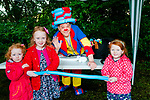 Listowel Writers Week: Hamish , Mia & Isabelle Curley pictured with Kenny the Clown at the children's events in the Listowel Town park on saturday last.
