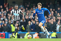 Marcos Alonso of Chelsea (right) during the Premier League match between Chelsea and Newcastle United at Stamford Bridge, London, England on 2 December 2017. Photo by David Horn.