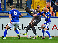 Lincoln City's John Akinde shields the ball from Macclesfield Town's Jamie Grimes, left, and Danny Whittaker<br /> <br /> Photographer Andrew Vaughan/CameraSport<br /> <br /> The EFL Sky Bet League One - Macclesfield Town v Lincoln City - Saturday 15th September 2018 - Moss Rose - Macclesfield<br /> <br /> World Copyright &copy; 2018 CameraSport. All rights reserved. 43 Linden Ave. Countesthorpe. Leicester. England. LE8 5PG - Tel: +44 (0) 116 277 4147 - admin@camerasport.com - www.camerasport.com