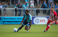 Anthony Stewart of Wycombe Wanderers loses his footing under pressure from Billy Kee of Accrington Stanley during the Sky Bet League 2 match between Wycombe Wanderers and Accrington Stanley at Adams Park, High Wycombe, England on 16 August 2016. Photo by Andy Rowland.