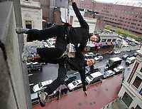 Boston, MA -  Aerial artists Heather Baer, right, and Rachael Lincoln of Project Bandaloop dance along a parking garage in the skies above Tremont Street in the Theatre District  suspended by ropes and harnesses on Thursday, May, 2006.