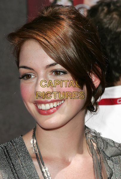 """ANNE HATHAWAY.Attends the World Premiere of Walt Disney Pictures' """"The Princess Diaries 2: Royal Engagement"""" held at AMC Downtown Disney in Anaheim, California,.August 7th 2004.portrait headshot grey top blush flushed rosy cheeks.Ref: DVS.www.capitalpictures.com.sales@capitalpictures.com.©Capital Pictures."""