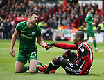 Paul Huntingdon of Preston North End helps up Leon Clarke of Sheffield Utd during the championship match at the Bramall Lane Stadium, Sheffield. Picture date 28th April 2018. Picture credit should read: Simon Bellis/Sportimage