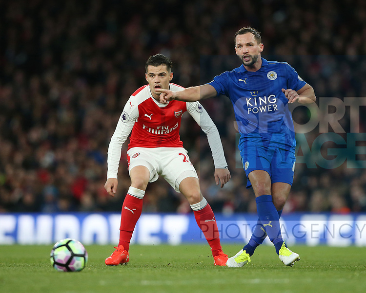 Arsenal's Granit Xhaka tussles with Leicester's Danny Drinkwater during the Premier League match at the Emirates Stadium, London. Picture date: April 26th, 2017. Pic credit should read: David Klein/Sportimage