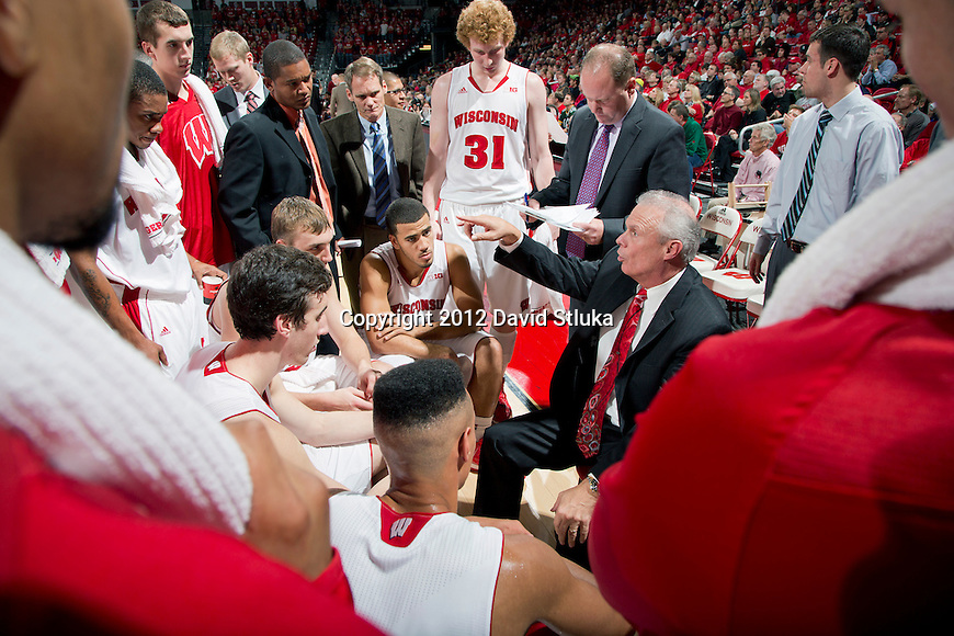 Wisconsin Badgers Head Coach Bo Ryan talks to his players during an NCAA  college basketball game against the Presbyterian Blue Hose Tuesday, November 20, 2012 in Madison, Wis. The Badgers won 88-43. (Photo by David Stluka)