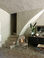 The original stone staircase leads up from the living room on the first floor to the master bedroom on the second