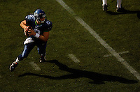 Sep 18, 2005; Seattle, WA, USA; Seattle Seahawks quarterback Matt Hasselbeck #8 scrambles to avoid defenders from the Atlanta Falcons in the fourth quarter at Qwest Field. Mandatory Credit: Photo By Mark J. Rebilas