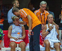 Arena Loire,  Trélazé,  France, 16 April, 2016, Semifinal FedCup, France-Netherlands, Double  Hogenkamp  (L) and Bertens (NED) loting in the third set of the fifth match and they are comforted for their los by fysio Edwin Visser (L) and coach Martin Bohm<br /> Photo: Henk Koster/Tennisimages