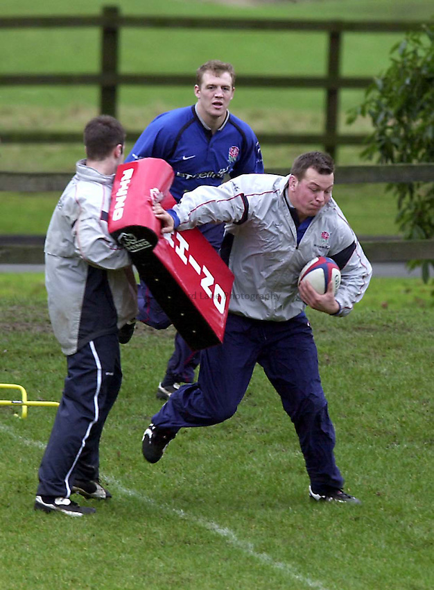 Photo. Richard Lane. .England Squad Training at Pennyhill Hotel, Bagshot.. 30-1-2002.New cap, Steve Thompson goes through his paces.
