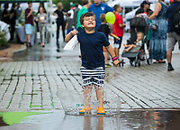 NWA Democrat-Gazette/BEN GOFF @NWABENGOFF<br /> Cade Journey-Culley, 4, of Bentonville jumps in a puddle Friday, June 7, 2019, during First Friday on the Bentonville square. This month the theme was 'Living Local' with a focus on local history, food, music and businesses.